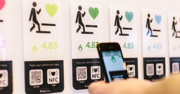 Stepjockey Smart Phone Reads Nfc Smart Poster In Stair Climbing Programme Room Signage Architectural Signage Signage