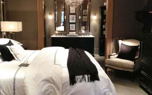 Master Bedroom... Dark walls with white bedding and crystal chandelier