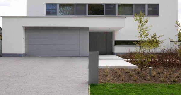 Moderne woning nieuwbouw witte gevel architect for K architecture kathleen cuvelier