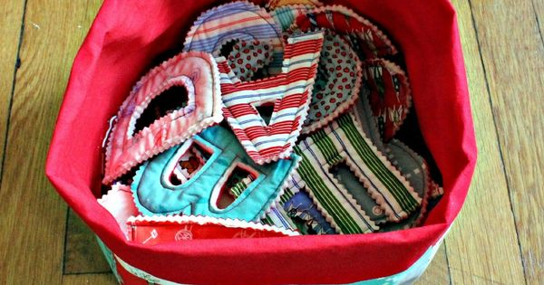 a bucket of letters made from scrap fabrics. Gift idea for my