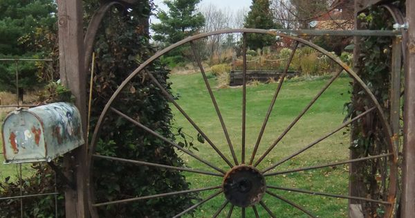 Old Hay Rake Wheel Repurposed As A Garden Gate Garden