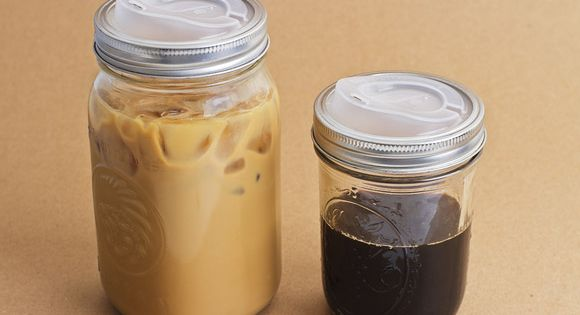 turn a canning jar into a travel mug! product called cuppow. Hmmm,