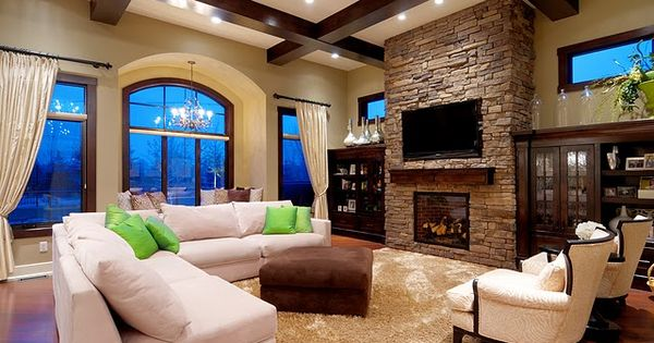 High ceilings, beams, feature brick wall, big windows; dream family room