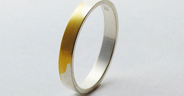 silver plated gold wedding band. rubbing the silver away with wear, symbolizes