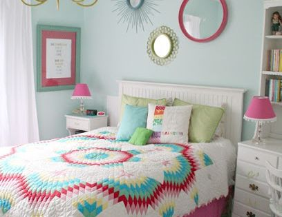 This cute pink girl's bedroom looks very much hand made. The quilt