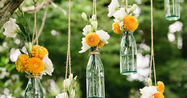 The idea of hanging vases from trees!!