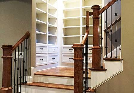 Built-ins at the stair landing in 4 Bed House Plan 24362TW ~2,800 sq. ft. with walkout basement Architectural Designs, readywhenyouare