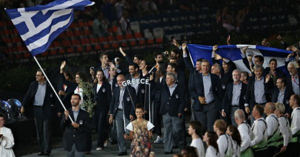 Greece S Flag Bearer Alexandros Nikolaidis Holds The National Flag As He Leads The Contingent In The Athletes Parade Olympic Games Greece Flag Opening Ceremony