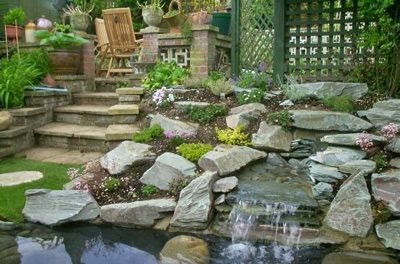 Xeriscaping rock steps and pond river rock landscaping for Garden pond rockery ideas
