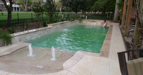 White Flagstone Beach Entry Pool With Travertine Coping