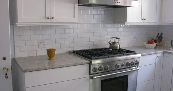 Kashmire white granite white subway tile dove grey grout for Galley kitchen backsplash ideas