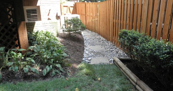 this gravel based stone walkway complements the