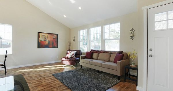 Kraft Project Living Room Tan Grey And Burgundy Colors Offset By Cream Walls And Vaulted