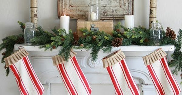 Christmas mantel with candy cane striped stockings