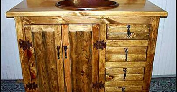 Photo of 42 inch rustic with the sink in the center Southwestern style bathroom vanities