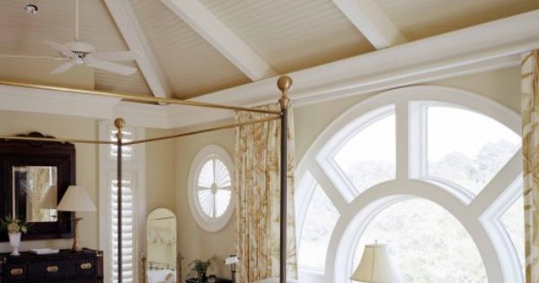 Great round window in master bedroom with high ceilings. Love.