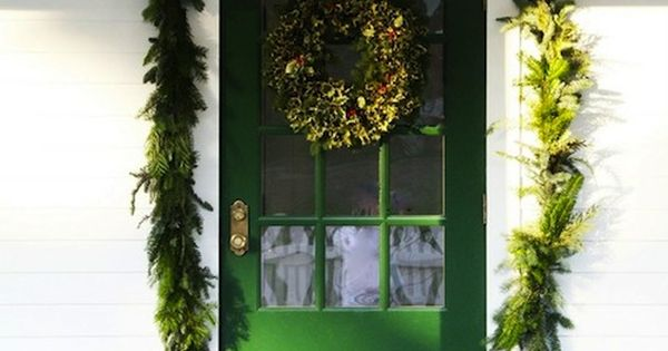 Beautiful green front door and garland. christmas winter greenery frontporchdecor
