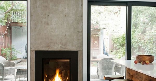 Wood Burning Fireplace Designed Between Glass Sliding