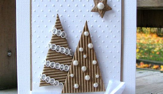 Christmas card simply stated in white and kraft...luv the corregated kraft paper