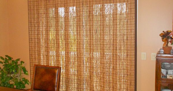Sliding glass door with averte woven wood woven wood for Natural woven flat fold shades