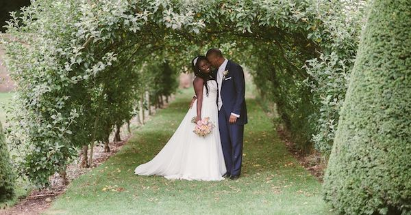 beautiful shot of the bride and groom in the grounds of a