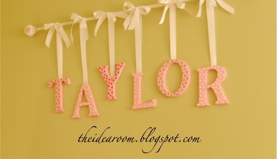Name wall hanging using a curtain rod. Cute idea for a young