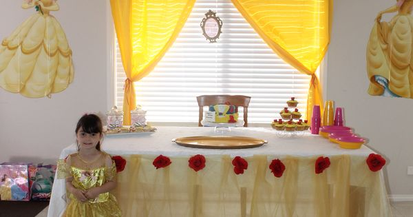 Food table tulle table skirt tissue paper pom poms for Beauty and the beast table and chairs