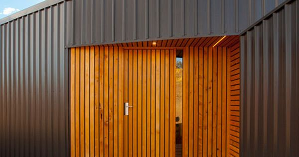 Rural Tasmanian House Has A Terrace Piercing Its Middle Piercing Middle And House