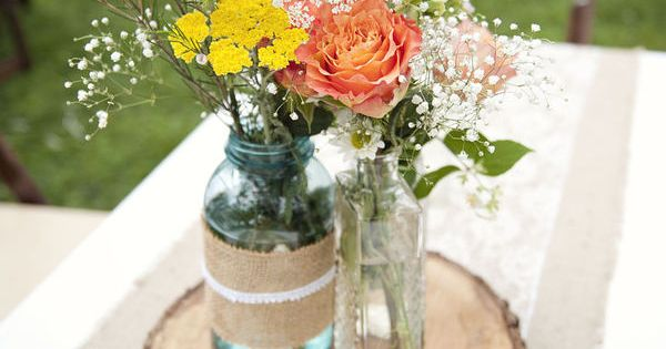 Simple Centerpieces. Burlap, lace and mason jars. (give or take the wood)