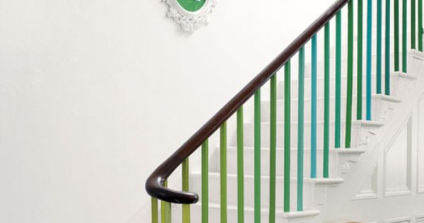 Banister colour. White painted stairs. Colours repeated on wall.