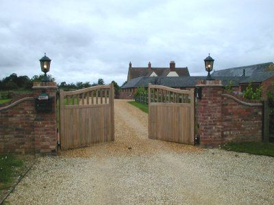 Pair Of Iroko Timber Automatic Electric Gates In Northamptonshire Electric Gates Wooden Gates Driveway Entrance Gates Driveway