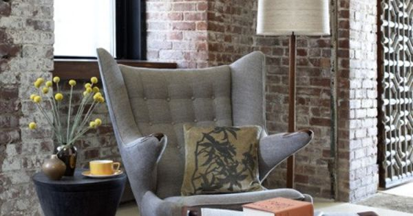 Classic Brick Wall Decoration and Grey Leather Chair in Living Room Interior