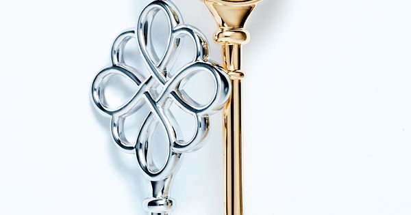 THE BLACK AND GOLD! Tiffany Keys knot pendants, from left: sterling silver