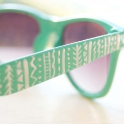 Write on the sides of sunglasses with nail art pen or paint