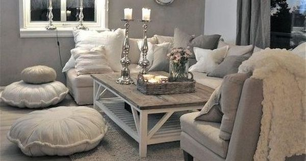 Neutral couch, grey and white pillows/ throws. Floor poufs and an accent arm chair Favorite ...