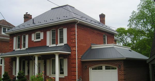 Brick House In Nova Scotia With A Metal Roof By Interlock