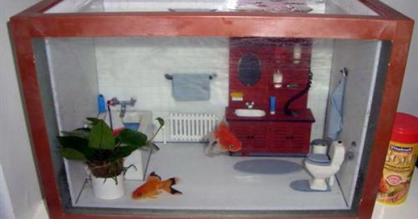 Fish tank decor. Looks like a doll house interior.
