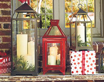 Christmas Lanterns - Love the multiple candles and greenery in the lanterns.