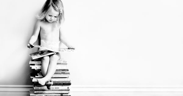 Cute. Love the stack of books as stool. Careful, though, this is