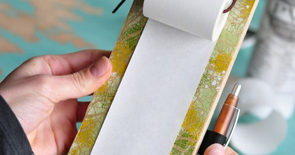 Receipt Paper Roll Hanging Notepad. Clever reuse of scrap material. This would