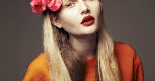 Cayenne Floral Crown and orange sweater with red lips