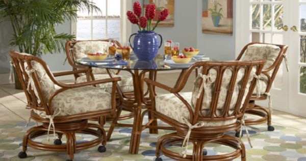 Charleston Dining Set With 4 Caster Swivel And Tilt Cane Chairs