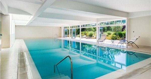 White Lane In Guildford England This Grand Estate Features An Indoor Swimming Pool With Steam