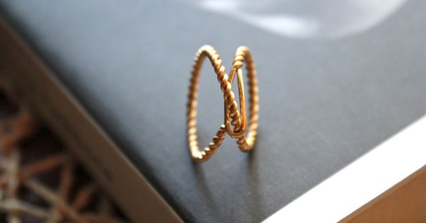An infinity knot in delicate gold by ElishaMarie. $35.00.