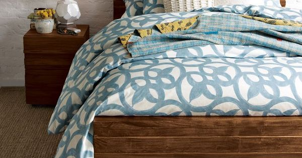 Master bedroom wood bed frame & blue comforter
