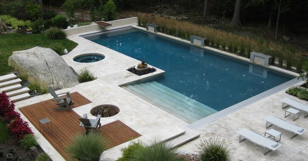 Everything about this pool and deck is absolutely perfect! Built in firepit.