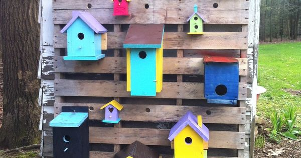 cute painted sheds | painted bird house attached to wooden pallet on the side of a shed ...