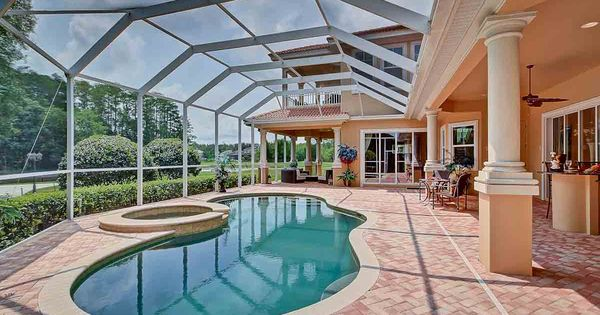 This golf course home for sale includes a large meandering for Heated pools for sale