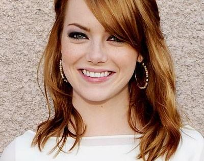 Emma Stone's Auburn Hair Color and side bangs