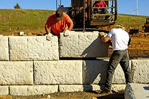 Homeadvisor S Retaining Wall Cost Guide Provides Estimated Prices For Building Materials Precas Retaining Wall Retaining Wall Cost Retaining Wall Construction